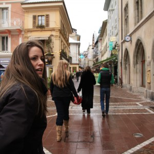 Caroline in Evian, with her family in the background.