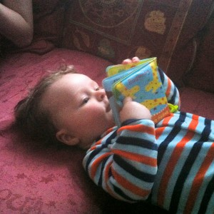 He hasn't quite got the hang of reading yet...