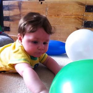 Reaching for a balloon